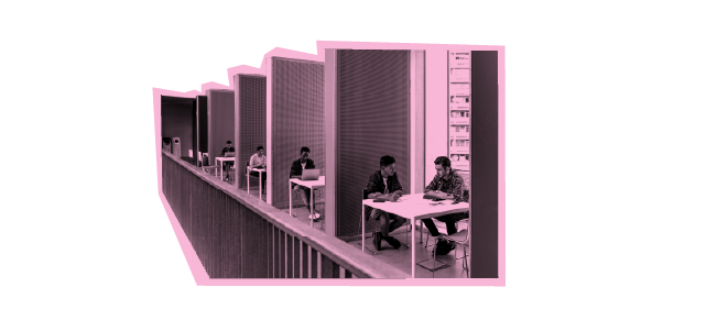 Students studying at tables in a library